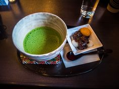 """As usual here are our choices for the afternoon: matcha green tea with a side order of anko (sweet red beans) gyuhi mochi and of anzu apricot. Standard fare for Asakusa's kissaten/café so also part of """"Bunshichi's"""" menu. 4/5 #Asakusa, """"Bunshichi"""", #kissaten, #café, #matcha, #gyuhi, #mochi, #anzu 4/6 March 13, 2016 © Grigoris A. Miliaresis"""