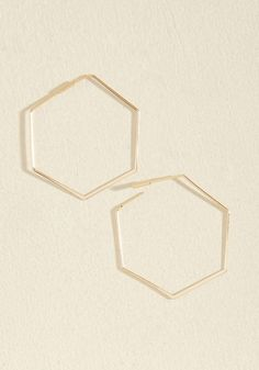 <p>Oh, how we endlessly adore these gold earrings! Giving the classic hoop a modern update with six sleek, shining, and subtly tapered sides, this geometric pair is one we'd love to gush about forever - but there simply won't be any stopping us!</p>