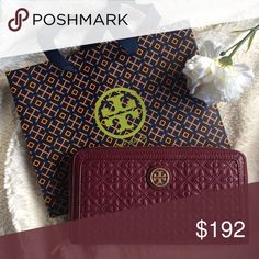 """Tory Burch Bryant Zip Continental Wallet Brand new with tags Tory Burch Bryant Zip Continental Wallet. Color: Red Agate (#606). Exterior: Embossed leather in a quilted design. Gold tone hardware. Interior: Pebble leather with Tory logo; jacquard fabric lining. 7.5""""L x 4""""H x 1""""W. Reasonable offers are welcome! ✨ Tory Burch Bags Wallets"""