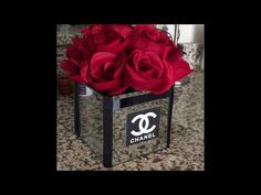 I LOVE-LOVE-LOVE the elegance of Chanel, but I'm not ballin' like that yet. I do want to add a sprinkle of class throughout my home and this is a very easy a. Chanel Room, Chanel Decor, Chanel Birthday Party, Chanel Party, Dollar Tree Flowers, Dollar Tree Decor, Chanel Flower, Glamour Decor, Diy Centerpieces