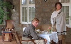 """Out of Africa"" - Meryl Streep (as Karen Blixen) & Robert Redford (as Denys Finch Hatton) on the veranda modeled after Blixen's coffee plantation in Kenya."