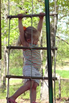 Maggie checking out the rope ladder on the playhouse