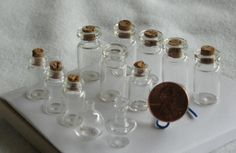 Small corked jars for an alchemist's room box.