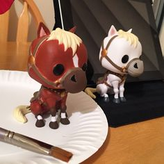 Funko Pop custom painting. Original on the right, custom on the left. This is Epona from Legend of Zelda.