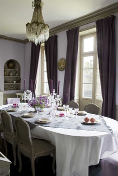 beautifully designed dining room in lavender, ivory and green. the