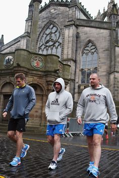 (L-R) Richie McCaw, Andrew Hore and Tony Woodcock of the All Blacks walk through the streets of Edinburgh on November 3, 2012 in Edinburgh, Scotland.