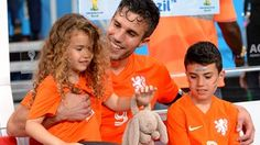 Robin van Persie of the Netherlands celebrates the win with his daughter Dina Layla and son Shaqueel