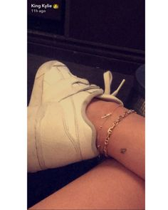 Kylie Jenner and her boyfriend Travis Scott debuted matching tiny butterfly ankle tattoos on Snapchat adding to her already extensive collection.