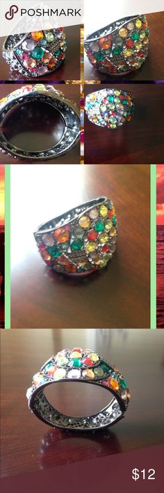 Bracelet Multicolor gem bracelet.   Opens up to adjust to wrist.  Purchased while in Philadelphia..can match a lot.  Very strong and durable Jewelry Bracelets