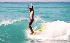 Hands up.. Sam Bleakley in Haiti.  Photo: JS Callahan #surfexplore