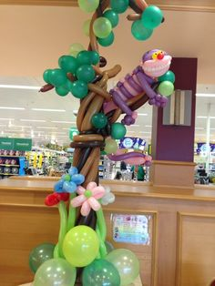 Cheshire Cat up a tree balloon sculpture