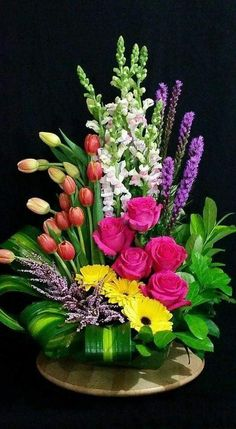 Floral arrangement with gerbera daisies, liatris, snapdragons, tulips, and Heather. Large Flower Arrangements, Funeral Flower Arrangements, Large Flowers, Fresh Flower Arrangement, Altar Flowers, Church Flowers, Funeral Flowers, Orchid Flowers, Gerbera Daisies