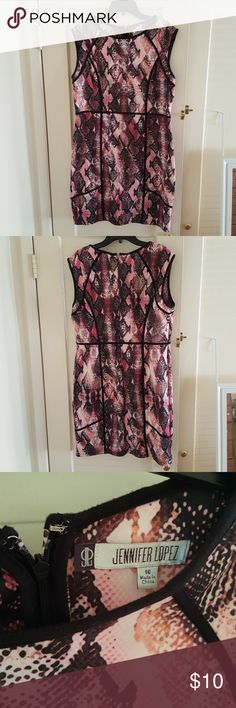Perfect dress for an evening out. Form fitting very comfortable JLo snake print dress.  Accentuates my curves perfectly.  Only wore twice. Jennifer Lopez Dresses Midi