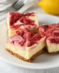Strawberry lemonade cheesecake bars are flavored with lemon and swirled with sweet strawberries. A taste of Summer in every bite!