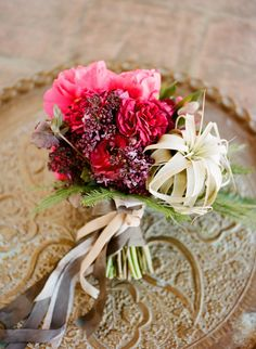 A uniquely spirited bouquet from Twig & Twine includes peonies, ranunculus, garden roses, hellebores, lilac, an air plant, and umbrella fern. Photo: Christina McNeill