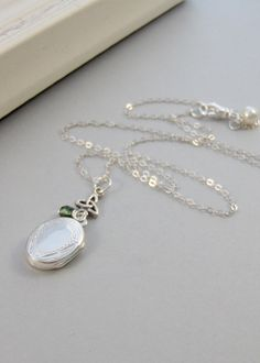Sterling Knot,Locket,Silver Locket,Sterling Silver Locket,Sterling Silver,Emerald,Irish,Clover. Handmade jewelry by valleygirldesigns.. $51.00, via Etsy.