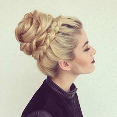 If you can't decide between a bun and a braid, go for both with this gorgeous high-rise bun with a crown braid.