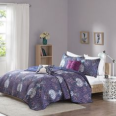 QUILT Bring a funky Bohemian style to your bedroom with the Giselle Coverlet Set by Intelligent Design. This gorgeous quilted set features an intricate paisley pattern rendered in shades of purple with turquoise accents and coordinating pillows.