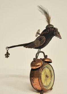 Steampunk assemblage bird on vintage copper alarm clock