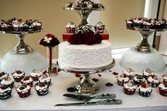 Red and Black Rose Cake- For their red and black theme, this couple decorated their embellished cake with deep red roses for a stunning contrast.