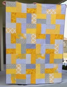 I finished up the quilting on my yellow and gray pinwheel quilt just in time to take it my guild 's picnic. It looks right at home in ...