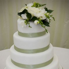 Sarah's auntie took a week off work to design and create the wedding cake for Sarah and Michaels wedding.  The white, four layer wedding cake had a sage green satin ribbon tied around each tier, and had been filled with flavours such as fruit, coconut, lemon and chocolate.  The wedding cake was cut as the evening guests arrived and was served on a buffet along with a selection of delicious barbeque food.After their first dance to Halo by Beyonce, newlyweds Michael and Sarah said goodbye to…