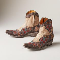 """MARRIONE ZIPPER BOOTS--Kick up your heels in bright, tropical flowers. Handmade by Old Gringo, featuring detailed embroidery on rich, chocolate leather. Inner side zipper. Imported. Whole and half sizes 6 to 10, 11. 1-1/2"""" heel. These are running 1/2 size larger."""