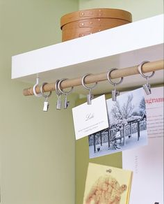 cup hooks, drapery rod hardware to hang photos, notes, etc