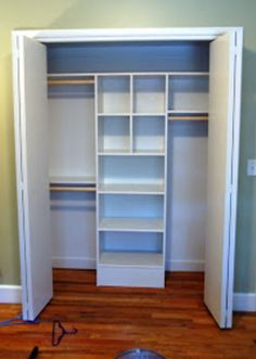 LOVE!!!! this designed closet for $82 at Tate the Side Street.  Insert cubbies and baskets to keep the closet organized.