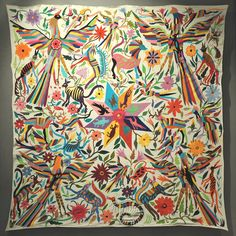 This colorful embroidered cloth was made in the Otomi community of Tenango de Doria, Hidalgo, Mexico. It is exhibited at the Museo de Arte Popular in Mexico City