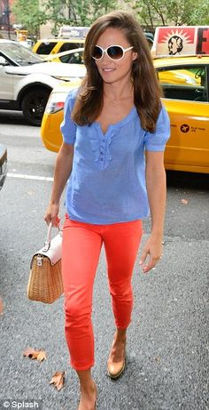 Pippa emerged from the vehicle looking polished as ever in a light chambray top, red jeans and her favourite beige wedges.