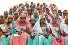 TIE THE KNOT: Brides sat together as they took part in a mass marriage ceremony during the Akshaya Tritiya festival in Bhopal, India, Monday. The festival marks what is believed to be the most sacred day for marriage in Hindu mythology. (Sanjeev Gupta/European Pressphoto Agency)