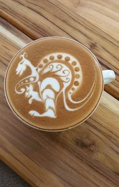 A previous pinner said this was kangaroo latte art; I think it is a dragon. It seems we agree that it's impressive either way.