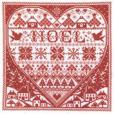 A pretty heart shaped design of motifs with a snowy village background.