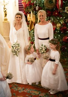 How cute are these flower girls wearing Little Eglantine creations? White dresses with burgundy velvet sashes are perfect for a Christmas / winter wedding! Designer Flower Girl Dresses, White Flower Girl Dresses, Flower Girls, Wedding Gift List, London Winter, Wedding Band Engraving, Burgundy Flowers, Evening Outfits, Silk Organza
