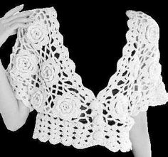 This bolero is crocheted in a free-form manner.  The creator gives general instructions on her site.  The rose motifs are crocheted and joined as the work progresses.  Shell border hem & cuffs, and neck edging complete the garment.