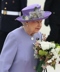 Queen Elizabeth II with a flowers bouquet, at the official welcome to Rome