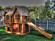 Front-right view with slide exit visible (Little Lodge two storey wooden children's play house : playhouse with slide custom made UK)