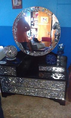old dressing table painted black then mosaic  with broken mirrors.