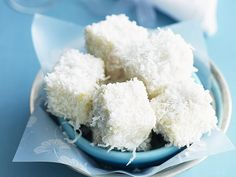 If you're looking for a new twist on an old favourite, these little white chocolate lamingtons are the business. Bite-sized pieces of feather-light sponge, dipped in white chocolate and coated in moist shredded coconut. Christmas Desserts, Fun Desserts, Dessert Recipes, Christmas Recipes, Christmas Foods, Tea Recipes, Cupcake Recipes, Kids Christmas, Dessert Ideas
