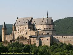 Buerg Veianen (Vianden Castle), Vianden, Luxembourg.  Vianden is one of the largest fortified castles west of the Rhine. Its origins date to the 10th century. The castle was built in the Romanesque style between the 11th and 14th centuries. Gothic aspects were added at the end of this period.