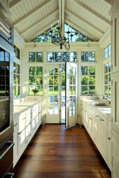 The galley kitchen flows right up to the large windows and door.  Love it.  Really like the ceiling too.  Wonder if I can get my own kitchen to have that ceiling.  Going to go look now and see!  You know, we could add the boards on our bedroom ceiling too for that timber house look!