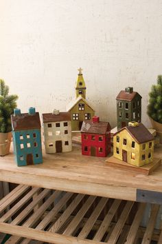 Kalalou Ceramic Village - Set Of 6 - This set of 6 ceramic buildings make the perfect Holiday village. With holes in the back for candles or string lights, this set is sure to become a family favorite for years to come.