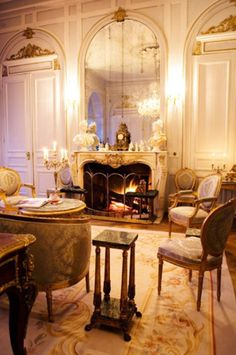Aubusson rug, fireplace, lighting, walls