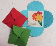 "This beautiful pouch was designed by packaging guru Bud Felson at Okina. They are designed to use as an interesting envelope to carry either a printed message or a seeded shape. The whole pouch can be planted and is available in Brilliant colors or choose white and print directly on the paper. It comes with a separate planting instruction card that can be logo'd with your message and company name. Not suitable for direct mail. 3.75""x8.75"" folded. 3.75"" L x 8.75"" W #RYWWE-FGCUF"