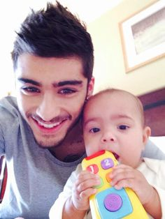 Pin for Later: 24 Hot Moments That Will Make You Want Zayn Malik Even More When He Made You Somehow Feel Jealous of a Baby