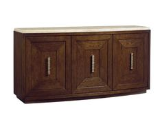A signature piece, the buffet features three doors that frame custom pulls and a sweeping convex top of silver travertine. The left and center doors open to reveal a full extension drawer, felt lined and divided for silver, and five adjustable shelves for additional storage.