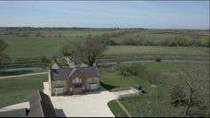 aerial view of the house, drive, grounds and canal