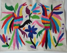 Unique embroidered placemats made from Otomi fabric. Our Otomi Mexico placemats have a unique animal design. Handmade with love by female artisans from Mexico. Buy now Mexican Textiles and Fair trade Textiles ! Mexican Embroidery, Ribbon Embroidery, Embroidery Art, Machine Embroidery Designs, Tribal Fabric, Mexican Fabric, Mexican Textiles, Unique Placemats, Ideas