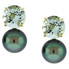 Donna Vock  9.15cts of green-blue beryl paired with deep green-blue 12 mm  Tahitian pearls in 18KYG.